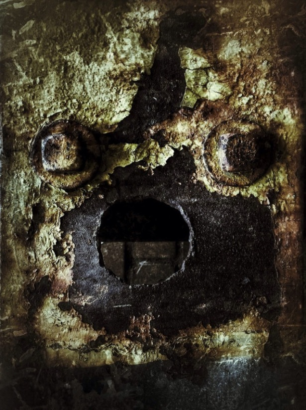 haunted-face-made-of-rust